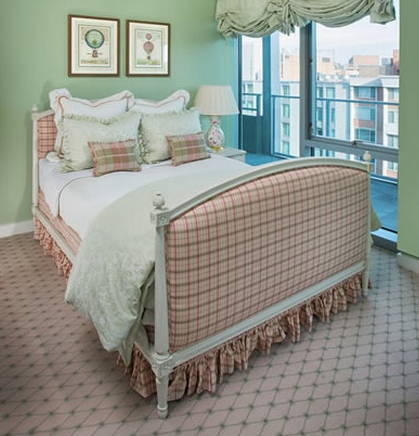 A pink-and-green plaid upholstered bed. Look by our interior designer Debbie Blair.