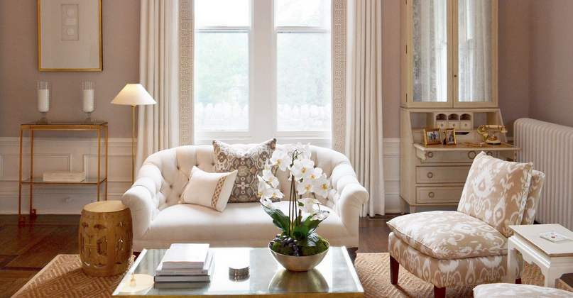Beige, white and gray pillows on a white sofa. Room by Diane Litz.